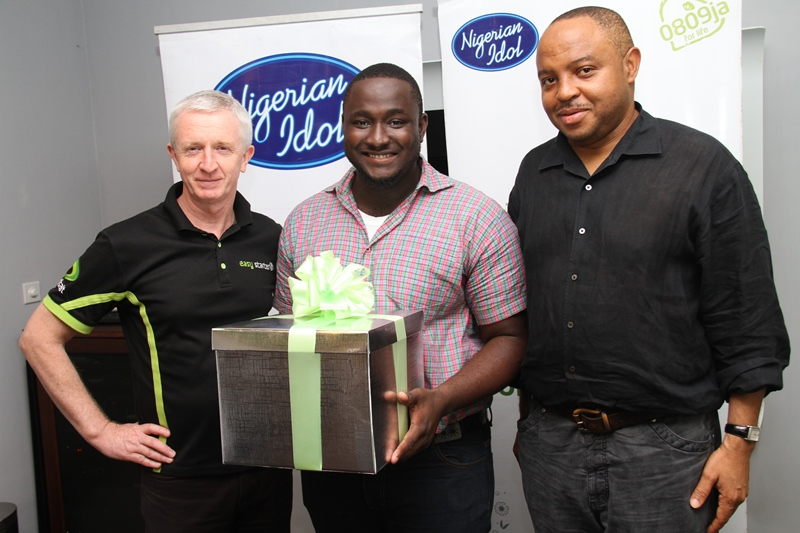 L - R: Chief Executive Officer, Etisalat Nigeria, Steven Evans; Nigerian Idol 3 Winner, Moses Obi-Adigwe, and Managing Director, Optima Media Group (OMG), Rotimi Pedro, during the first and exclusive listening session of the winner's maiden music singles, held at Etisalat Headquarters on Banana Island, Lagos, on Friday, 14th June, 2013
