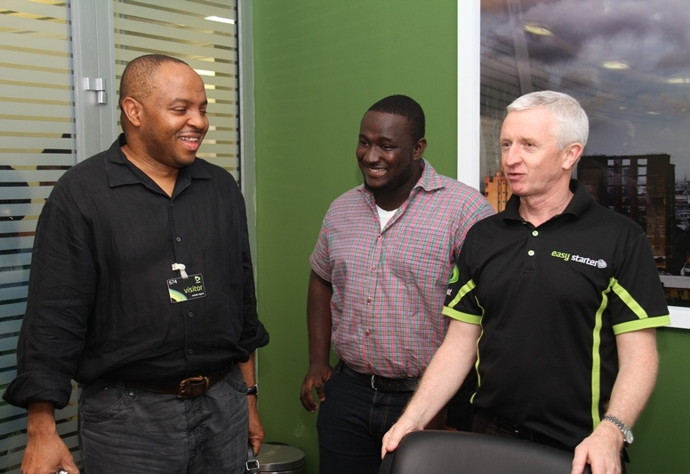 Chief Executive Officer, Etisalat Nigeria, Steven Evans (right) welcoming Managing Director, Optima Media Group (OMG), Rotimi Pedro (left) and Nigerian Idol 3 Winner, Moses Obi-Adigwe (middle) to his office during the first and exclusive listening session of the winner's maiden music singles, held at Etisalat Headquarters in Banana Island, Lagos, on Friday, 14th June, 2013