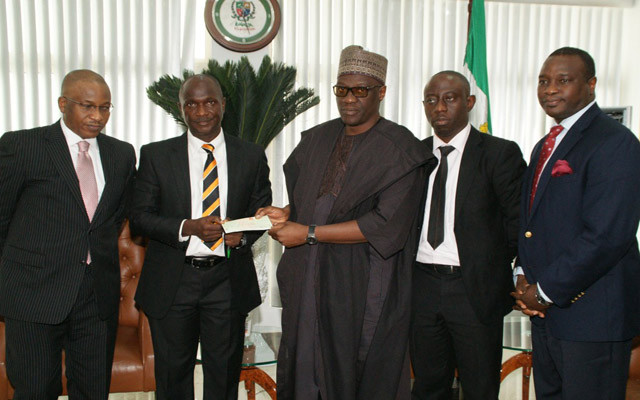 L-R , Director, KCMB Micro Finance Bank, Mr. Alex Okoh; Commissioner for Finance and Chairman Board of KCMB Micro Finance Bank, Alhaji Demola Banu; presenting Cheque of Kwara State's Dividends to the State Governor, Alhaji Abdulfatah Ahmed while CEO, Mr. Abayomi Ajayi  and a Director of the Bank, Mr. Seyi Oyawoye, at Government House Ilorin...Wednesday.