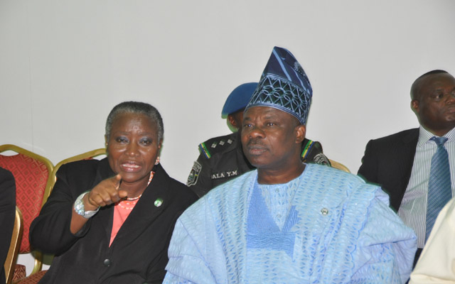Ogun State Governor, Senator Ibikunle Amosun and Ogun State Head of Service, Mrs. Modupe Adekunle putting heads together at the 4th Summit of Heads of Service, South-West Geo-Political Zone held in Abeokuta on Tuesday.