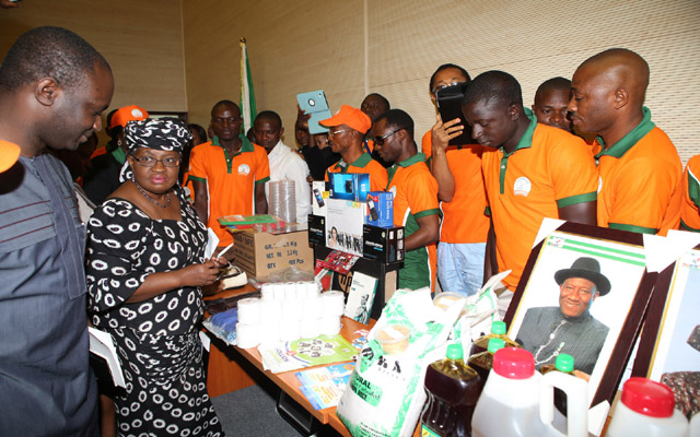 L-R; CME/Minister of Finance, Dr. Ngozi Okonjo-Iweala, accompanied by Project Coordinator YouWin Programme and SA to CME/HMF. Dr. Supo Olusi Cross section of Beneficial of YouWin  during inspectionof Some Product and thank you by YOUWIN First Batch winners at the Ministry in Abuja./ PHOTO; SUNDAY AGHAEZE JULY 1 2013.