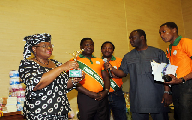 L-R; CME/Minister of Finance, Dr. Ngozi Okonjo-Iweala, being presented with a plague from the Beneficial of YouWin and MD Hessolast Packaging Industry, Mr. Akintuesi Femi, CEO/MD Tribes Art Africa, Mr. Rodney Asikhia, Project Coordinator YouWin Programme, Dr. Supo Olusi and MD/CEO NetMatrix, Mr. Tunji Suleiman during a interactive and thank you by YOUWIN First Batch winners at the Ministry in Abuja./ PHOTO; SUNDAY AGHAEZE JULY 1 2013.