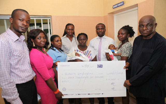 R-l; Group Admin Manager, Mr. Inno Anoliefo, Peace Ogwuche, Dept of Pediatrics Garki General Hospital, Dr. Ugowe Osagie, Mother of the Twin Babies, Omowmi Olaniyi, PRO Chrome Grome Group, Miss Loretta Epuechi, Registered Nurse/Midwife Garki General Hospital, Ms. Larbara Ibrahim, Corper Ms. Alaba Olukotun (link for the baby) and PR officer Chrome Group Mr. Ekpo Chukwuemeka during the Presentation of $4,000 for the treatment of Twin Baby Kehinde Olaniyi who was born with Multiple Congenital Deformity two months ago at the Garki General Hospital in Abuja. PHOTO; SUNDAYAGHAEZE