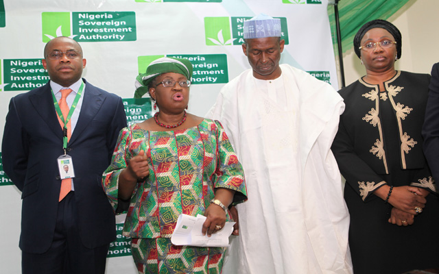 R-L; Coordinating Minister of the Economy and Minister of Finance, Dr. Ngozi Okonjo-Iweala (being welcome by the MD/CEO Mr. Uche Orji and Chairman Board of the Nigeria Soveregn Investment Authority (NSIA), ALh Mahey Raseed  during Minister's First official Visit to the NSIA Office in Abuja. PHOTO; SUNDAY AGHAEZE. AUG 1 2013.