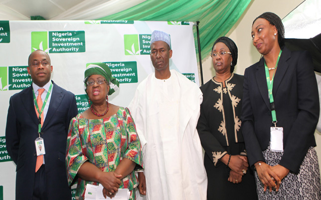 NSIA PIX 4. MD/CEO Mr. Uche Orji, Coordinating Minister of the Economy and Minister of Finance, Dr. Ngozi Okonjo-Iweala, Chairman Board of Nigeria Soveregn Investment Authority (NSIA), ALh Mahey Raseed, Member of the Board, Mrs. Olabisi Soyebo SAN AND Executive Director/ Chief Risk Officer NSIA, Mr. Stell Ojekwe-Onyejeli during Minister's First official Visit to the NSIA Office in Abuja. PHOTO; SUNDAY AGHAEZE. AUG 1 2013