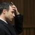 Oscar Pistorius gestures during his trial for the murder of his girlfriend Reeva Steenkamp, in Pretoria