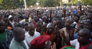 Army spokesman speaks to anti-government protesters outside the military headquarters in Ouagadougou