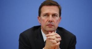 German government spokesman Seibert listens during a news conference of Chancellor Angela Merkel in Berlin