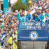 Chelsea players in an open-top bus parade through London