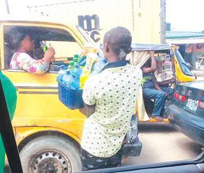 Image result for buying goods in lagos traffic