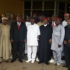 Gov. Ifeanyi Ugwuanyi of Enugu State flanked by some elders of the state during a symposium
