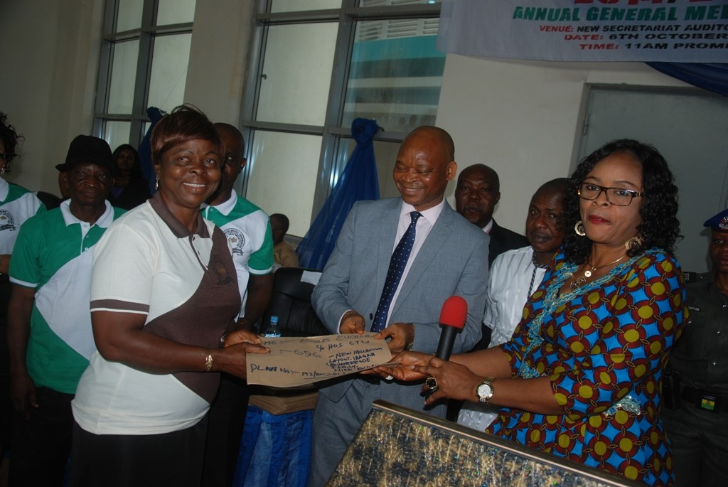 deputy-governor-of-enugu-state-mrs-cecilia-ezeilo-and-state-head-of-service-mr-chidi-ezema-jointly-presenting-a-land-document-to-a-beneficiary-in-enugu-yesterday