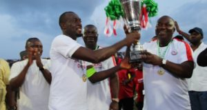 governor-ifeanyi-ugwuanyi-of-enugu-state-lifting-the-nigeria-professional-football-league-trophy-with-rangers-international-fc