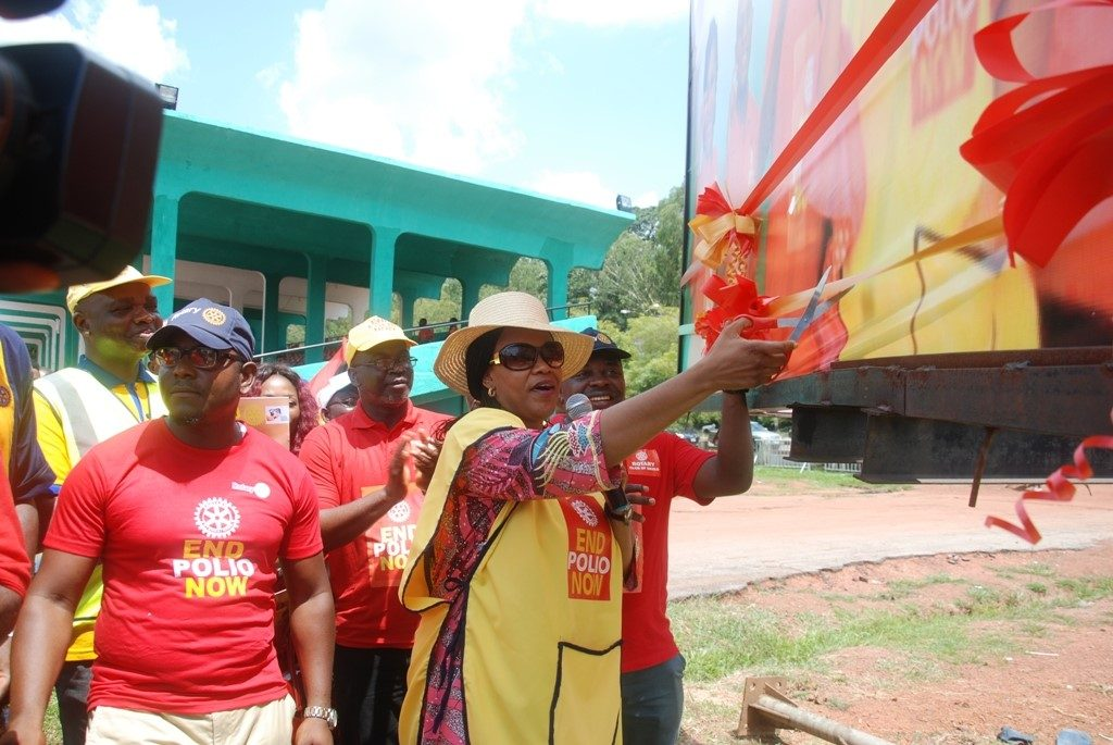 wife-of-enugu-state-governor-mrs-monica-ugwuanyi-cutting-the-tape-to-flag-off-world-polio-day-programme-at-michael-okpara-square-enugu-yesterday