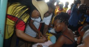 wife-of-enugu-state-governor-mrs-monica-ugwuanyi-immunizing-a-baby-as-part-of-activities-marking-world-polio-day-at-polly-clinic-asata-enugu-yesterday