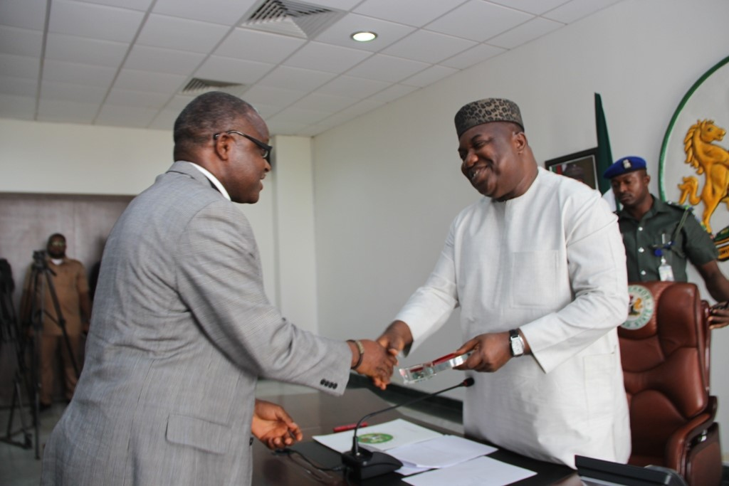 Gov. Ifeanyi Ugwuanyi of Enugu State, receiving The Man of the Year 2016 award from the Deputy Chairman, Editorial Board of Enugu Local Government Area News Magazine, Rev. Fr. Dr. Emeka Ngwoke