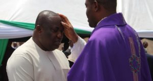 Gov. Ifeanyi Uguwanyi of Enugu State , being administered with ash on his forehead by Government House Chaplain, Rev. Fr. Chinedu Ozude, during a holy mas