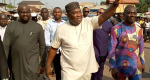 Gov. Ifeanyi Ugwuanyi of Enugu State acknowledging cheers from residents of Agbani in Nkanu West Local Government Area