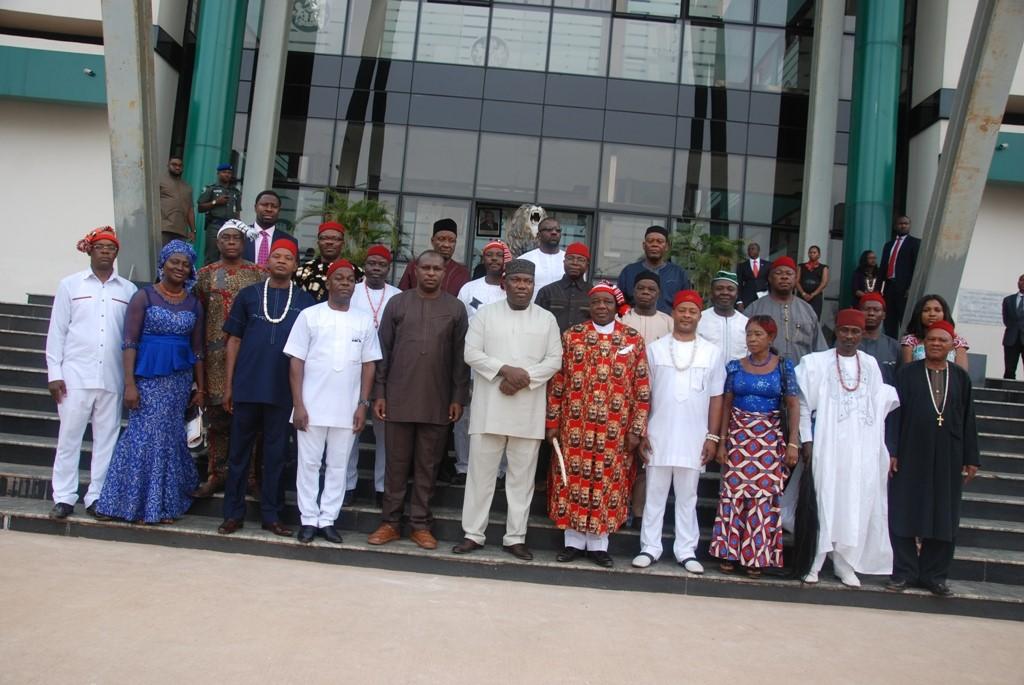 Gov. Ifeanyi Ugwuanyi of Enugu State flanked by members of the Ohaneze Ndigbo.